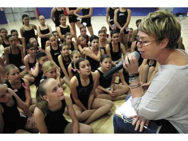 World renowned choreographer Mia Michaels speaks to the girls from the STARS competition team from The Dance Experience studios, Wednesday evening at Arroyo Seco Junior High School.