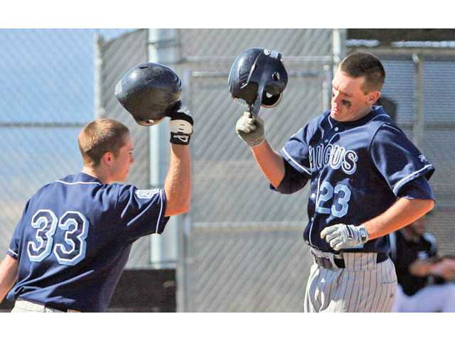 Saugus' Justin Sheehan, right, is congratulated by teammate Matthew Emerson after hitting a home run in the fourth inning on Friday at Golden Valley High. Saugus won 7-4.