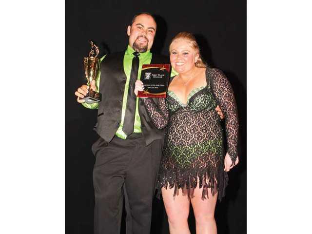 Alex Hafizi and partner Riley Bennett earned top honors for the SCV Senior Center.