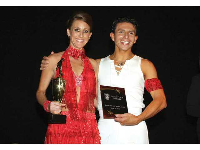 Kim Goldman and partner, Willy Arroyo, tied for second place in fundraising.
