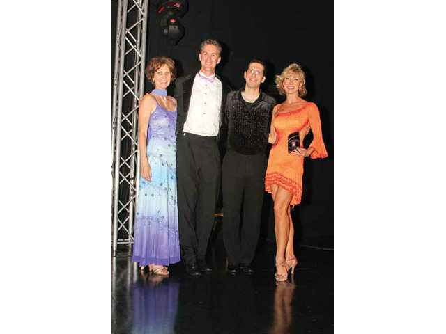 "Right to left, Carla Moore and Stephen Takeo, Nick Dale and Janine Jones. Takeo and Jones were named ""Best Male and Female Dancers"" at the Dancing With Our Stars event."