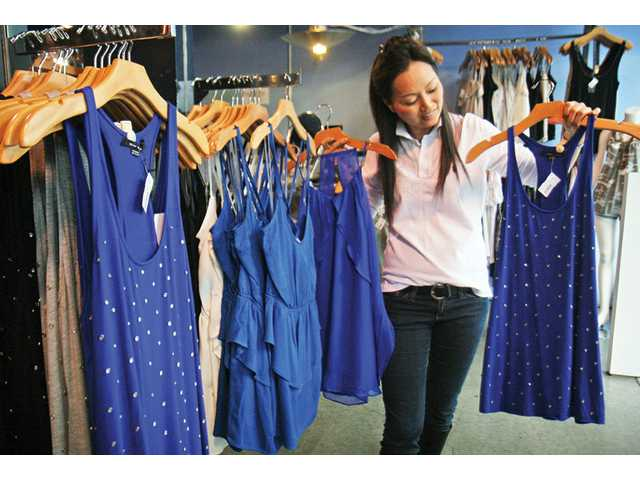 Angie Jang, store manager at the ANGL clothing store at the Westfield Valencia Town Center, said one of the biggest trends this spring is royal blue. Other spring fashion trends include boxier, looser clothing and tunics with leggings and jumpsuits.