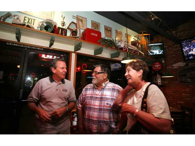 George Thomas, left, owner of Route 66 Classic Grill, talks with Santa Clarita residents Mike and Ruthann Levison, April 22 at the Canyon Country eatery. Mike Levison is president of the Southern California Harley Riders Association.