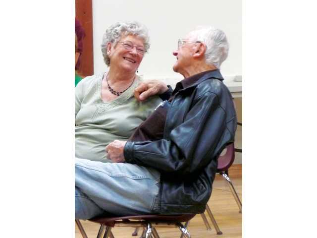 Bev and Louie Moll met at a Friendly Valley bingo game in 2004, and married two years later. The couple often shares lunch at the Senior Center, along with adoring gazes and smooches.