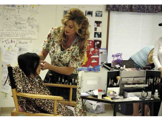 Valerie Riccardi, professional makeup artist and mom, does the make-up for the students during a skit at Bouquet Canyon Elementary School's Career Day.