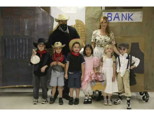 The cast of the Career Day skit at Bouquet Canyon Elementary School. Mark Riccardi (top left), Valerie Riccardi (top right), (bottom left to right) Dominic Riccardi, Kyle Mattox, Jake Mattox, Natalie Choo, Jacqueline Gracey, and Jarod Griswald.