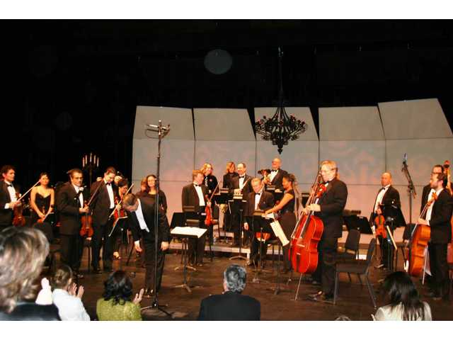 The Santa Clarita Symphony, seen here in a recent performance at the Santa Clarita Performing Arts Center, will spark musical fireworks at Concerts in the Park July 5.