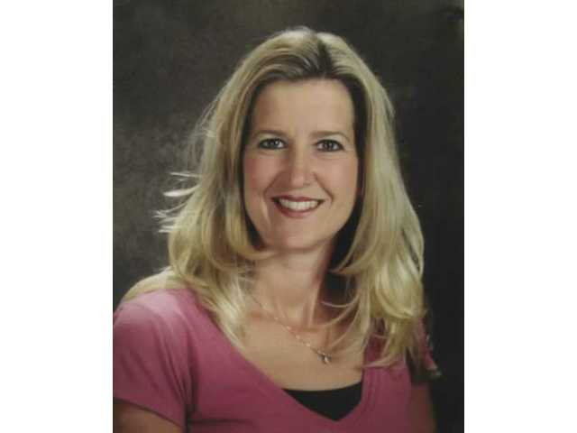 Joy, who worked at the school as a teacher, lost her battle with cancer on Nov. 17, 2007.