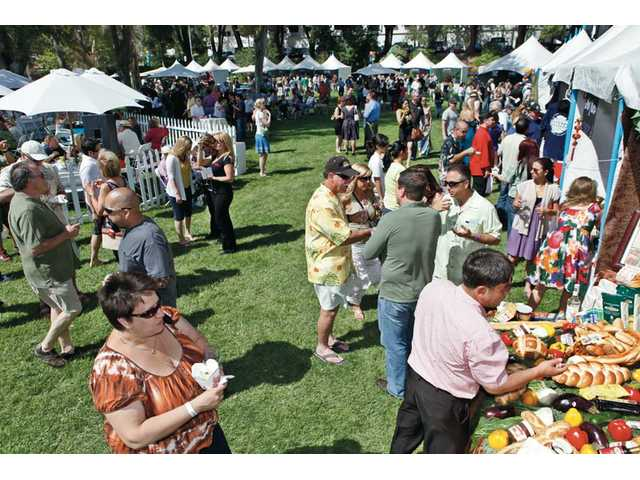 Crowds sample food and drinks from different vendors during Child & Family Center's Taste of the Town event held at Mann BioMedical Park in Valencia on Sunday. The event, which is now in its 22nd year, raises funds for the Child & Family Center.