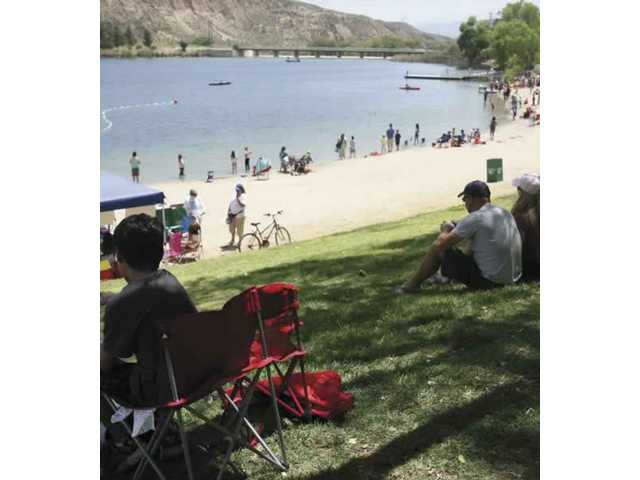 Families gather for Castaic Days Saturday morning at Castaic Lake. The event, which kicked off Friday night, continues today with a 5k/10-mile run, live music and sailboat rides.