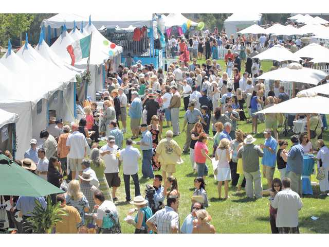Nearly 2,000 attendees fill the lawn at Taste of the Town held Sunday at Mann Biomedical Park in Valencia.