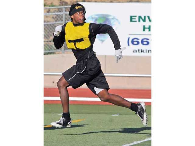 College of the Canyons wide receiver Cameron Bailey runs to make a catch during practice at Cougar Stadium on April 29.