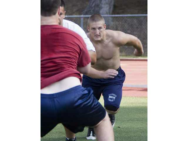 Saugus High graduate Ryan Zirbel works out with the College of the Canyons during spring practice.