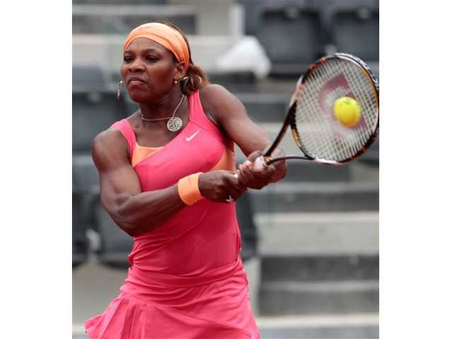 Serena Williams of the US returns the ball to Switzerland's Timea Bacsinszky during their match at the Italian Open tennis tournament, in Rome, Tuesday, May 4, 2010. Williams won 7-6(2), 6-1.