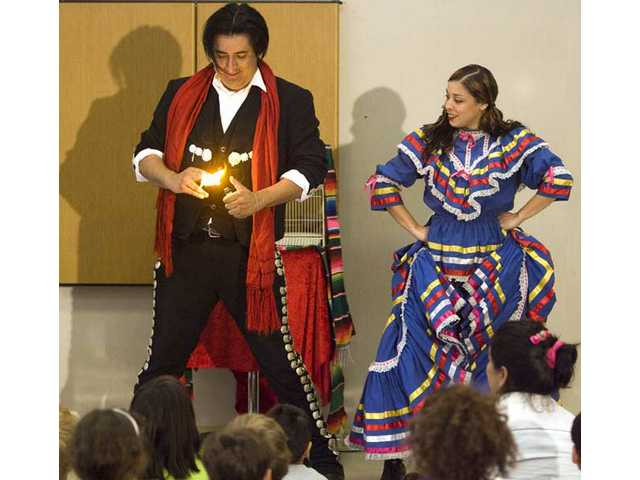 In celebration of Cinco de Mayo, Rafael Gomez and Katia Lopez perform to a group of kids and adults at the Canyon Country Jo Anne Darcy Library Monday afternoon during their Mariachi Magic Show.