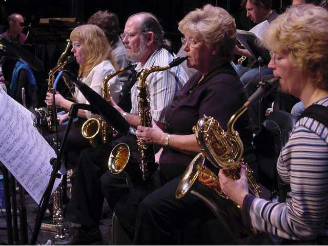 The award-winning COC Studio Jazz Ensemble's front line sax section rehearses for their upcoming gig.
