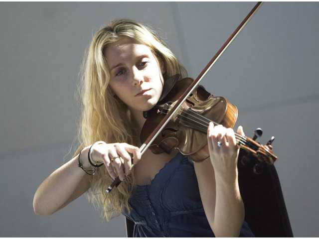Alessandra Barrett plays violin at a workshop in October inside The Wild Beast, a multiuse facility at California Institute of the Arts. Cal Arts will host a concert there Saturday at 8 p.m.  See story, A3.