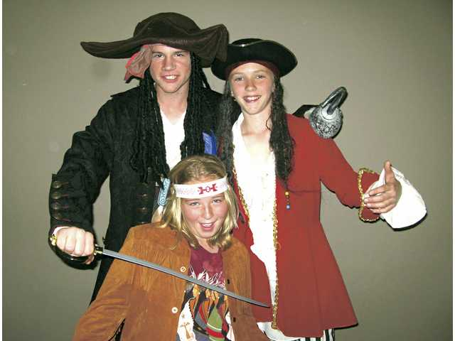 """Peter Pan"" cast members Christan Cranert, left, Griffin Krumrine and Olivia Sowers."