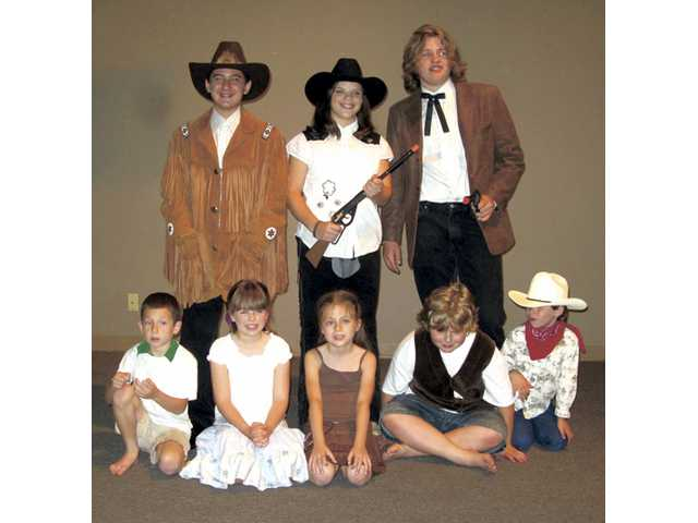 "The cast of ""Annie Get Your Gun"" clockwise from left: Justin Aria, Jenny Cranert, Duncan Krumrine, Kevin Steinfeld, Kimmy Floyd, Amber Bond, Holden Boutelle and Hunter Pack."
