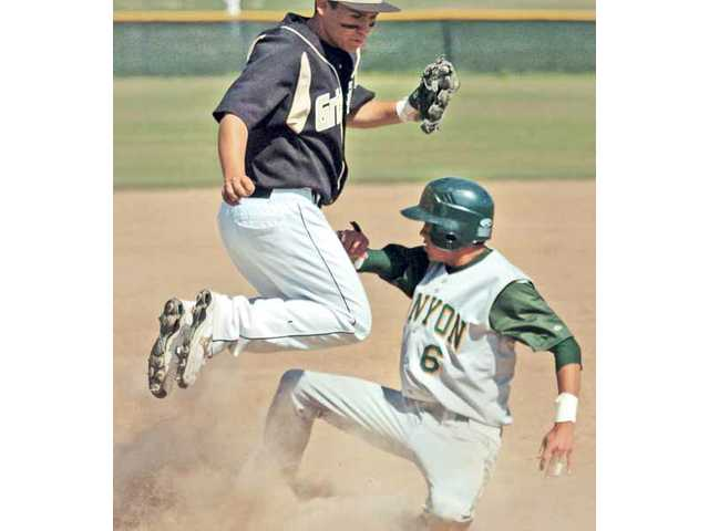 Golden Valley High School's Anthony San Miguel, left,  hops over Canyon High base runner Thomas Kratky, after making the tag at third base during Golden Valley's 3-0 win on Wednesday. The two teams will face off again today at Canyon High.