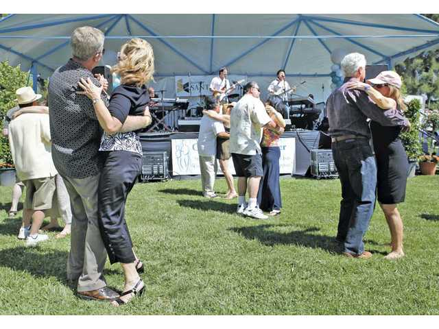 Guests dance to Ambrosia at Taste of the Town.