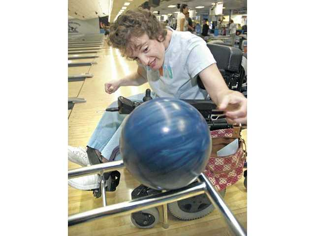 College of the Canyons student Jennifer Hoffman, 23, bowls from her wheelchair at Santa Clarita Lanes on Wednesday.