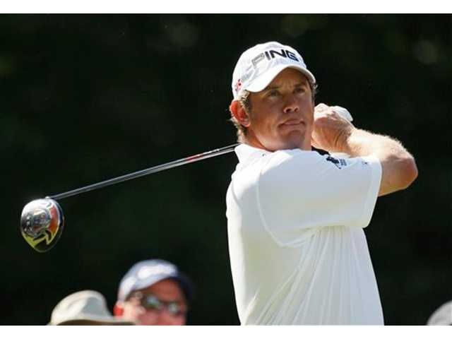 Lee Westwood of England watches his shot off the 15th tee during the second round of The Players Championship golf tournament Friday, May 7, 2010, in Ponte Vedra Beach, Fla.