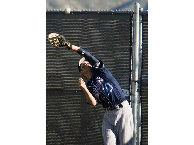 Saugus' Stefan Cordes attempts to catch a foul ball against Golden Valley Wednesday at Golden Valley High School. The Centurions won 3-1.