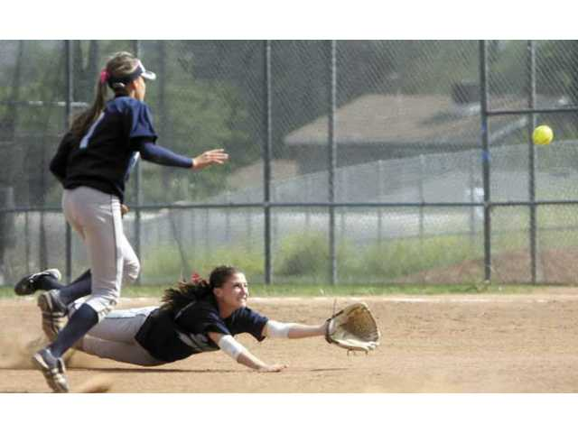 Saugus second baseman Nikki Daher dives for a ball in the game against Valencia on Tuesday. The Vikings defeated the Centurions 14-3.