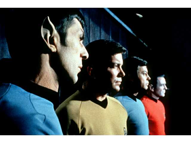 "This undated file photo shows actors in the TV series ""Star Trek,"" from left, Leonard Nemoy as Spock, William Shatner as Captain Kirk, DeForest Kelley as Doctor McCoy and James Doohan as Scotty."