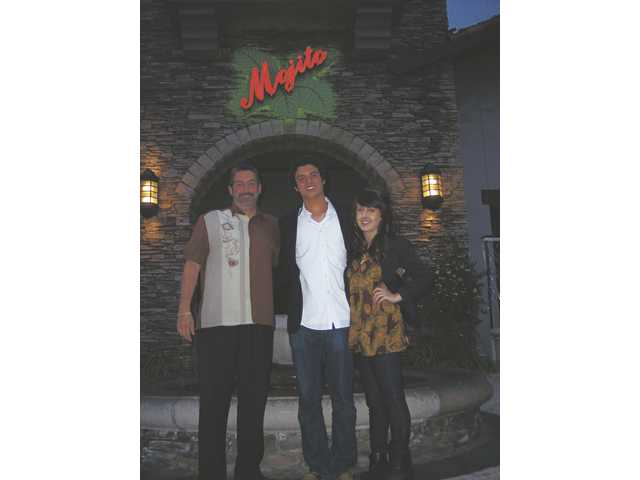 "Roland Verdecia, left, owner of Mojito, with The Signal's ""Cutest Couple"" William Haddad and Hannah Kirk."