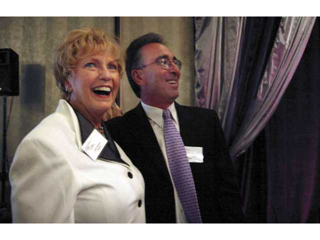 Judy Penman and Carl Goldman react after being named the Santa Clarita Valley Woman and Man of the Year for 2008 Friday night at the recognition dinner at the Valencia Hyatt grand ballroom.