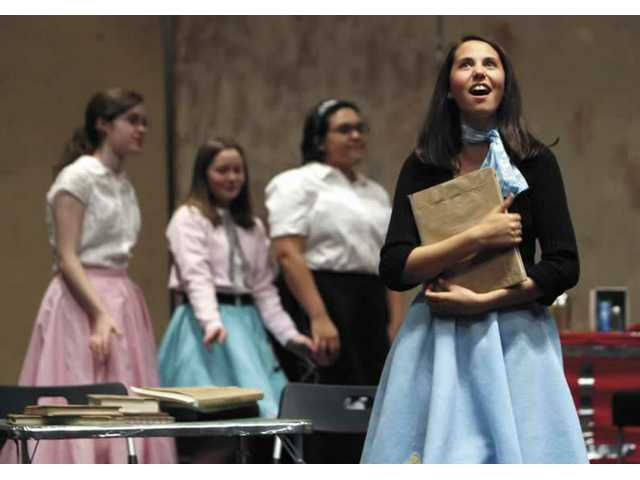"Alyssa Whitley sings a song during the dress rehearsal of the musical ""The Nifty Fifties,"" Tuesday evening at the Newhall Church of the Nazarene. The play will kick off Friday at 7 p.m. and Saturday at 11 a.m., 3 and 7 p.m., at the church. The cast is made up of a group of home-schooled students. The play is directed by Judy Barringer and Cherie Shefton."