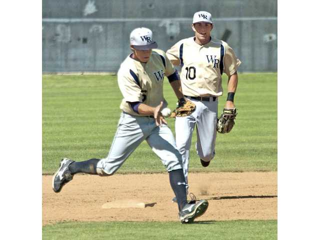 West Ranch shortstop Randy Poe, left, bare-hands a ground ball in the first inning as teammate Hunter Hernandez looks on at Hart High School on Friday afternoon. The Wildcats beat the Indians by the score of 10-7.