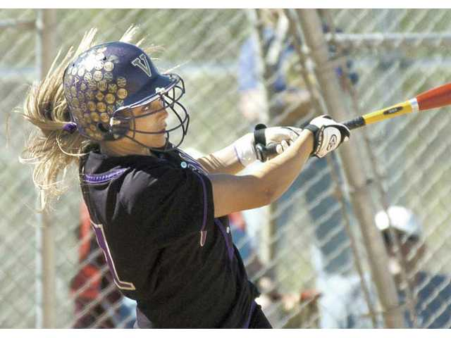 Valencia's Madison Shipman swings through a home run against West Ranch during the third inning Thursday afternoon at West Ranch High.