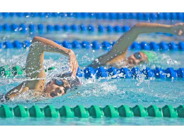 Hart High School's Nicole Antoniuk, front, trails Canyon's Adria Morales during the 500 freestyle Thursday at the Santa Clarita Aquatic Center.