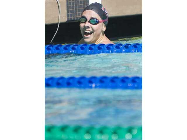 Hart High School's Chelsea Griffiths celebrates after winning the 100-yard freestyle.