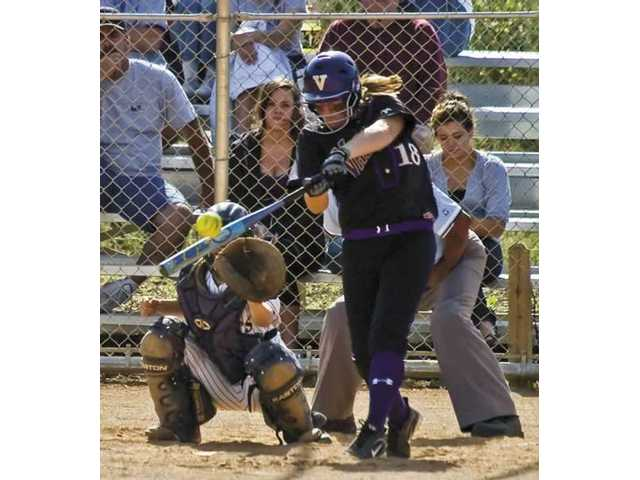 Valencia High's Annie Dreher belts her first home run-a solo shot to left field in the fifth inning. The 14-0 victory gave Valencia its eighth straight title.