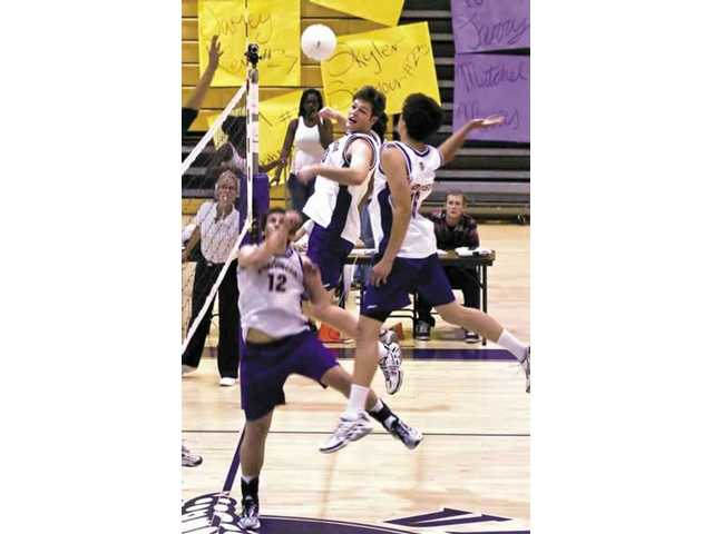 Jon Souisa of Valencia gets set to spike against Irvine in the opening round of the CIF playoffs at Valencia High on Monday. The Vikings won in three straight games.