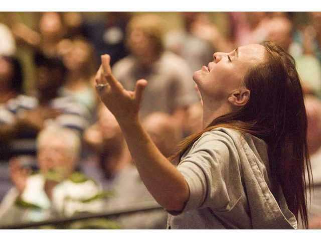 Julie Kliewer prays during the National Day of Prayer event at The Church on the Way Santa Clarita on Thursday.
