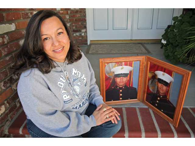 Connie Acevedo at her Newhall home with pictures of her two eldest sons, 21-year-old Andrew and 19-year-old Peter, both Marines. Acevedo also has a 15-year-old daughter, Paulina, who is now in the Young Marines program.