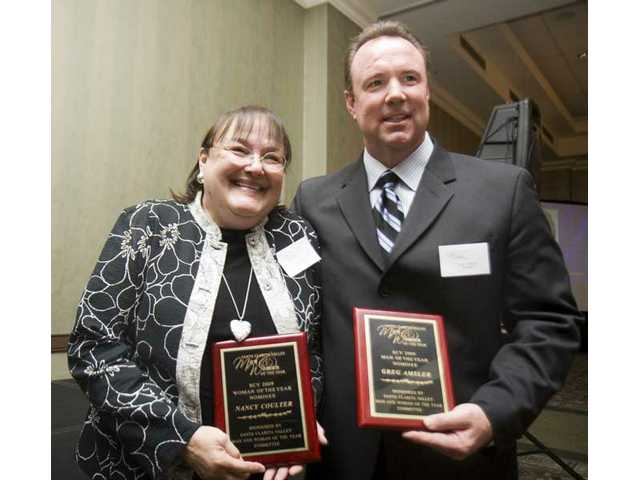 The 2009 Man and Woman of the Year awards were given to Nancy Coulter and Greg Amsler.