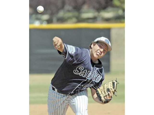 Saugus pitcher Tommy Kister deals against Golden Valley on Friday at Saugus High. The Centurions won 17-5 to stay alive in the league title chase.