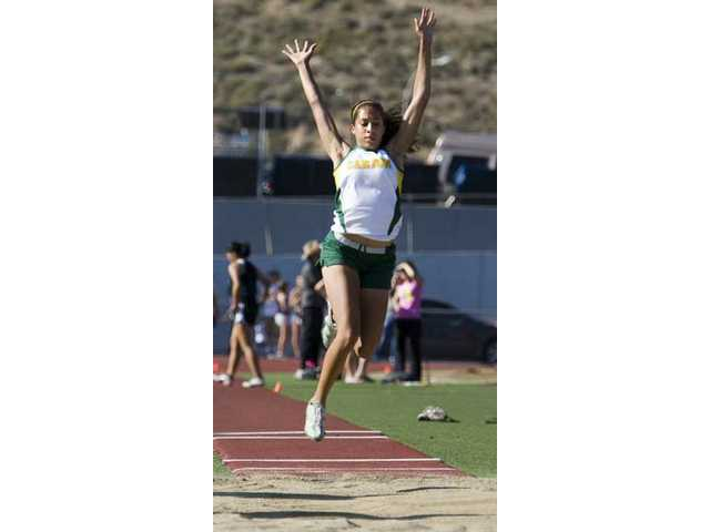 Tiffini Stone of Canyon skies in long jump.