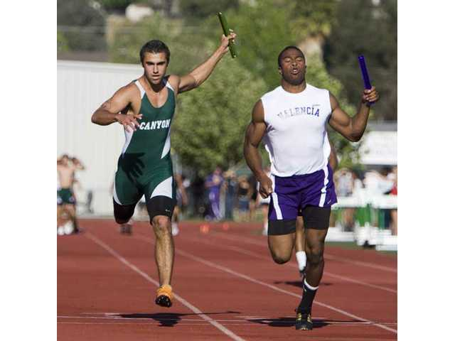 Valencia's Darrol Mitchell crosses the finish line just before Canyon's Nick Lotfi in the 4x100 relay.