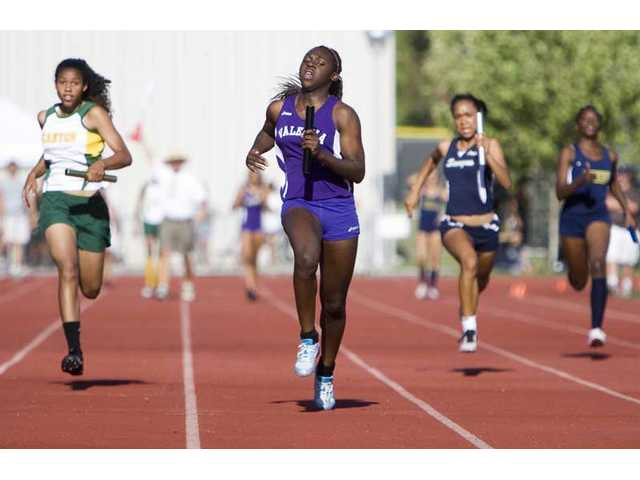 Valencia's Faith Anumba, second from left, runs the anchor leg of the girls 4x100-meter relay as Canyon's Layana White (far left), Saugus' Amber Wright  (second from right) and West Ranch's Courtney Thornton (far right) chase Friday at Canyon High.