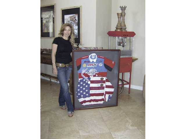 Terri Cadiente poses with her World Record memorabilia for Women's Slalom Jet Ski, which she set with 23.04 seconds on July 24, 1994. The record still stands today.