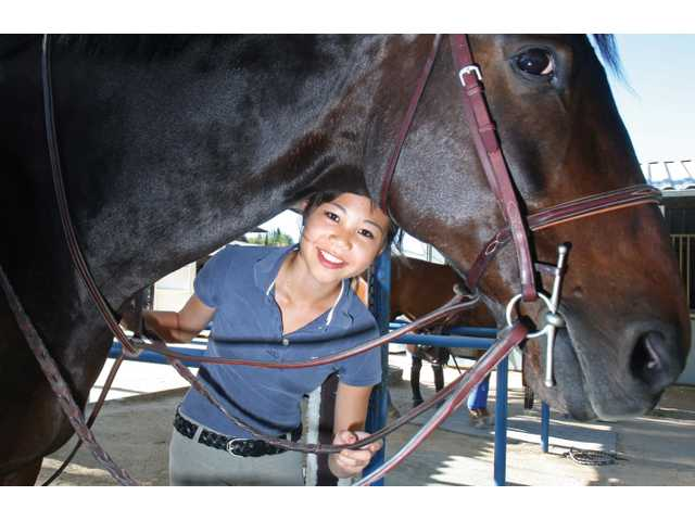 Valencia High School sophomore Jane Kang and her horse Monte may participate in a lesser-known sport, but they have formed a strong bond and done well in competitions, including a first-place finish at the Los Angeles Interscholastic Equestrian League's final competition of the year in late April.