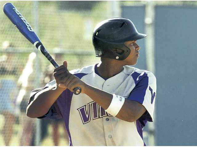 Valencia's Trey Williams awaits a pitch Friday against West Ranch. Williams and several other youngsters have helped the Vikings to the league lead.