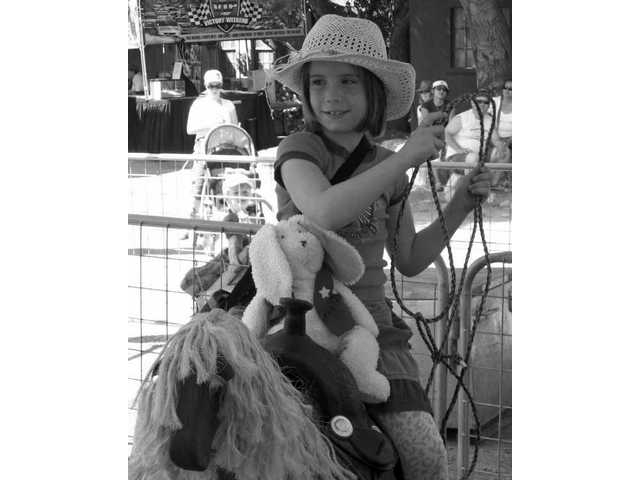 Damara Ganyo and Felix the bunny take a ride at the Santa Clarita Cowboy Festival on April 26.
